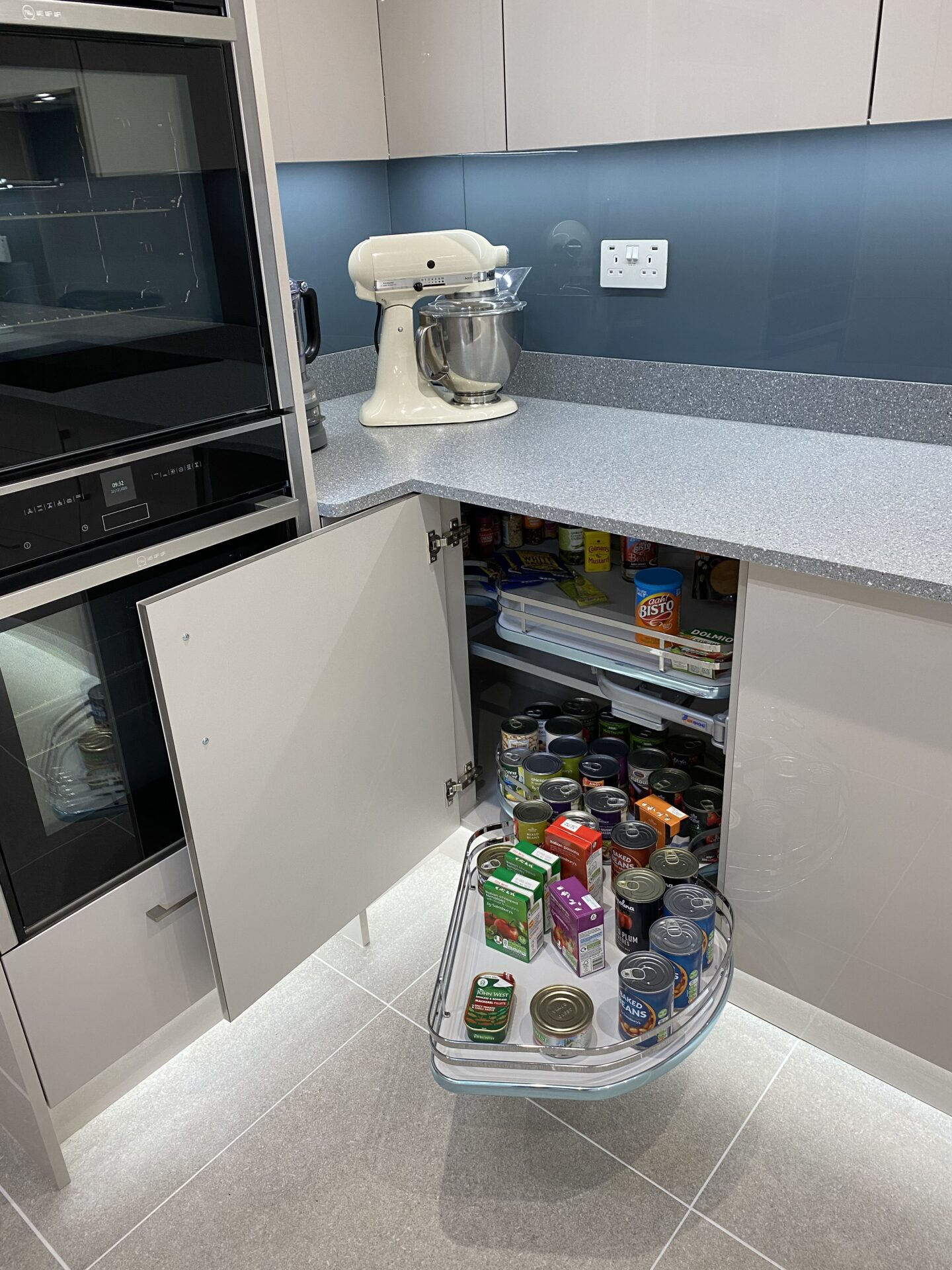Corner kitchen storage system as pull out accessory
