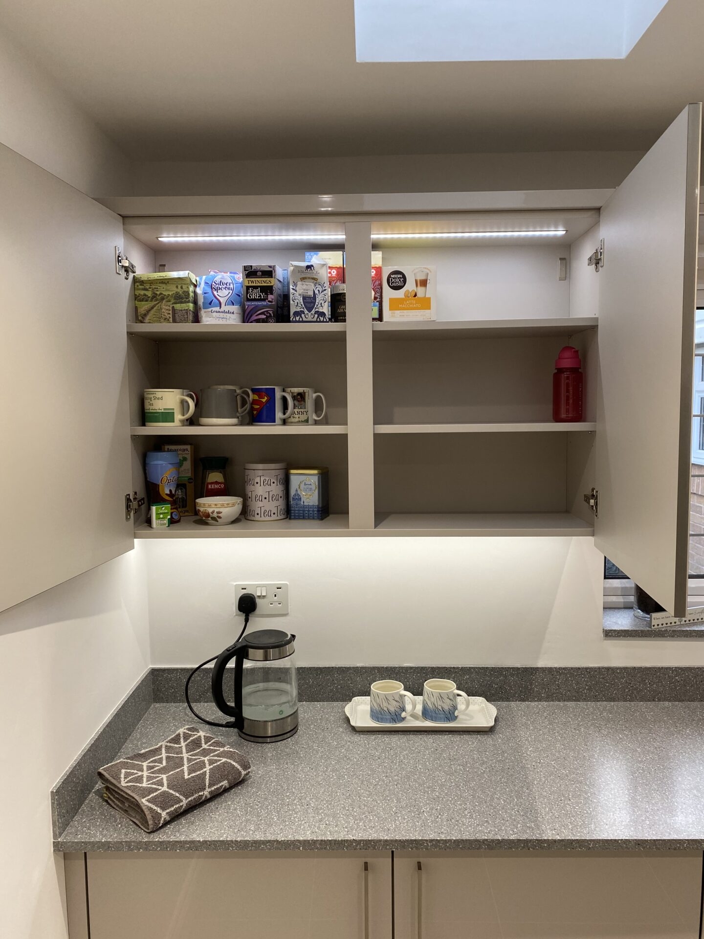 Kitchen wall cabinet with internal led lighting