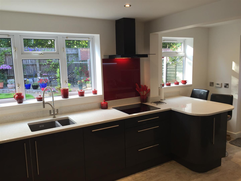 Ultra Gloss Kitchen with Quartz Worktops and Red Backsplash - Priorslee, Telford