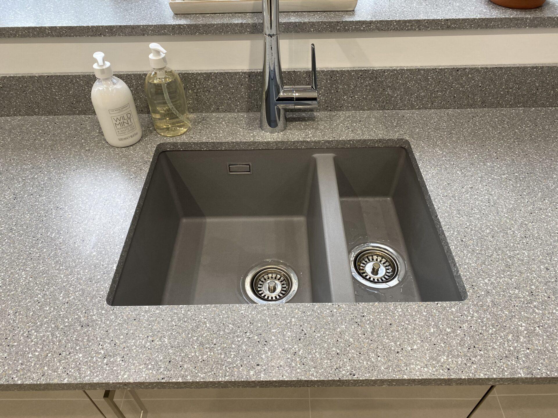 Undermount kitchen sink set in solid acrylic work surface