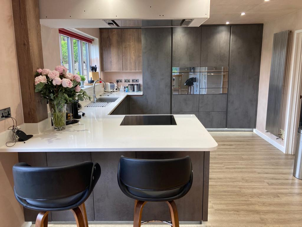 German Handle Less Dark Concreto Kitchen with Solid Quartz - Admaston